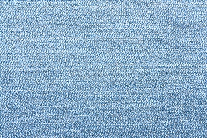 Textura azul clara de los vaqueros Fondo del dril de algodón imagen de archivo libre de regalías