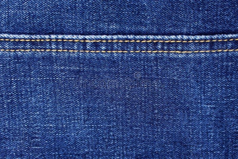 Textura azul con los modelos de costura del hilo doble, tela del dril de algodón de los vaqueros para el fondo imagen de archivo libre de regalías