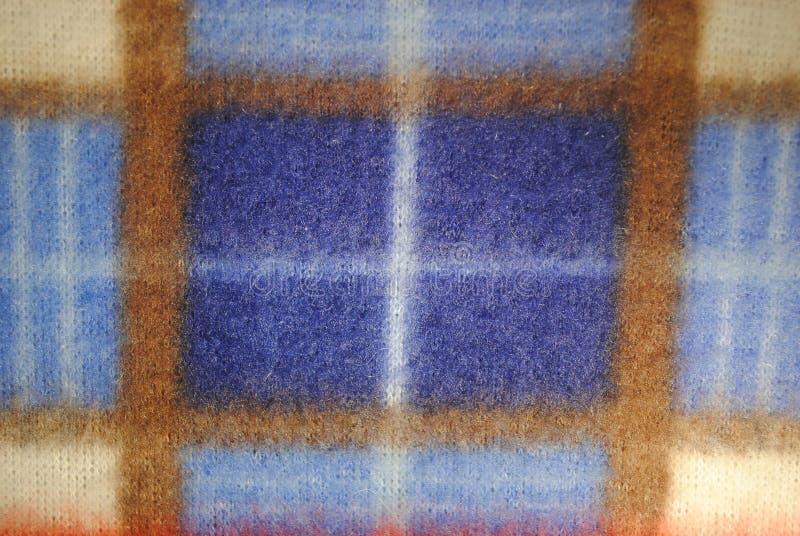 Textura azul de la tela del paño grueso y suave imagenes de archivo