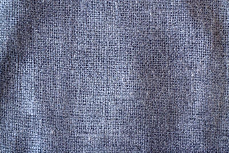Textura azul de pano de saco da cor com efeito do borr?o imagem de stock