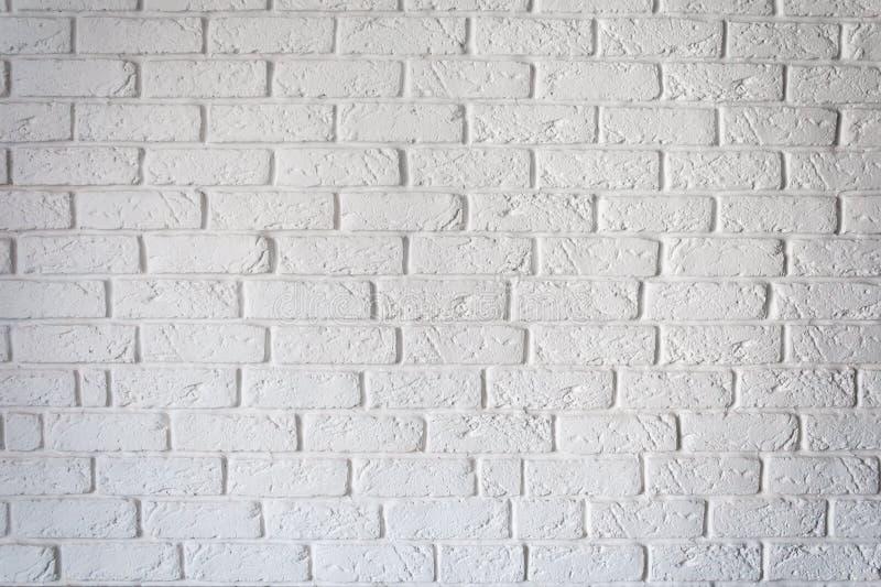 Textura branca áspera decorativa do fundo da parede de tijolo foto de stock