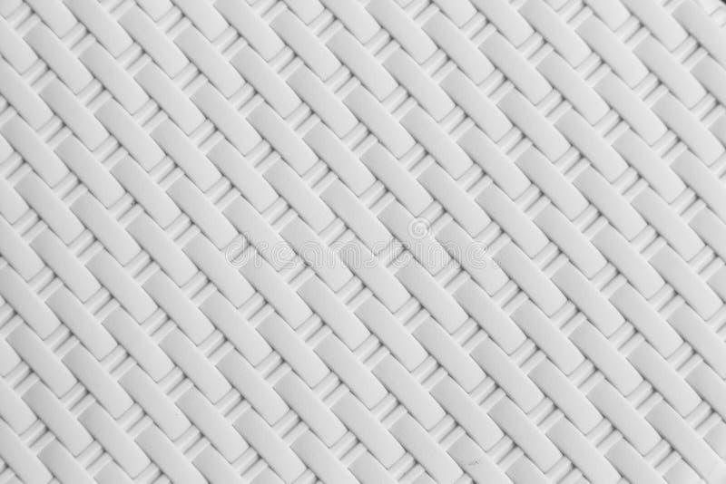 A textura branca do rattan, detalhe handcraft o fundo de tecelagem de bambu da textura fotografia de stock