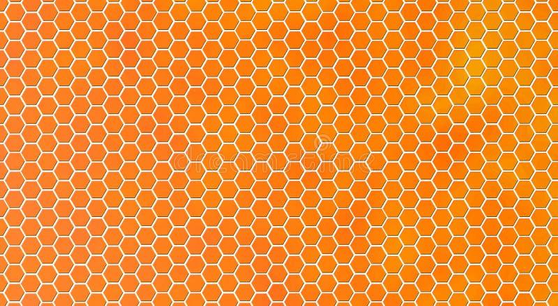 Textura brilhante abstrata do favo de mel no fundo alaranjado imagens de stock royalty free
