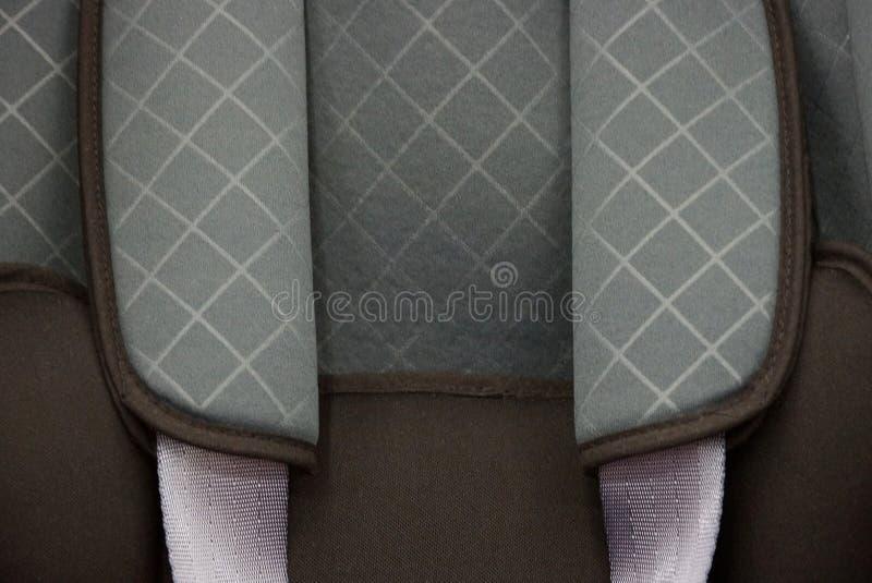 Textura cinzenta da tela do fragmento do assento da criança foto de stock