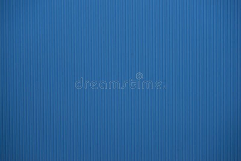 Textura coloreada azul clara de la cartulina acanalada útil como fondo foto de archivo