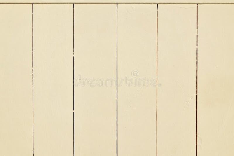 Textura completamente beige, de madera del fondo del panel del tablón del tablero de la pared imagenes de archivo