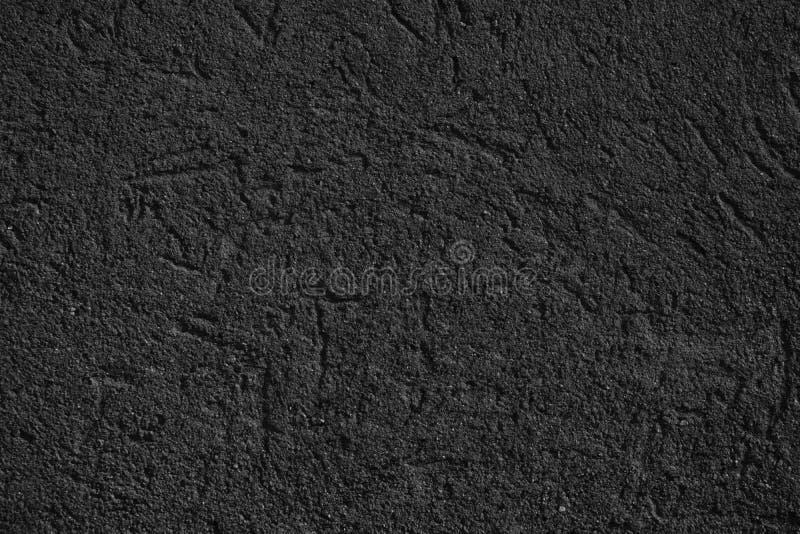 A textura concreta do emplastro monocromático, superfície da pedra, balança fundo rachado para o cartão fotografia de stock