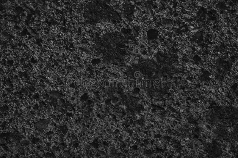 A textura concreta do emplastro monocromático, superfície da pedra, balança fundo rachado para o cartão imagens de stock royalty free