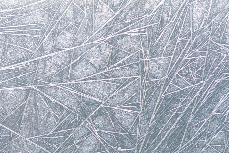 Textura congelada del modelo del hielo de ventana, copos de nieve y fondo helado, primer, foco suave fotos de archivo