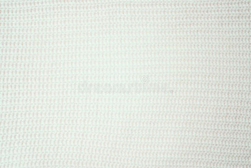 Textura cor-de-rosa listrada da tela da malha, fundo feito malha do teste padrão fotos de stock