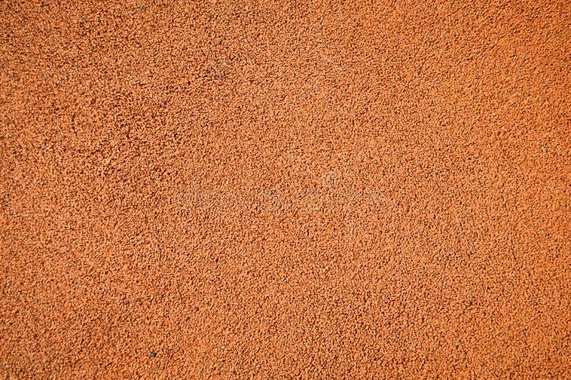 Textura corriente atl?tica roja de la pista en un estadio imagenes de archivo