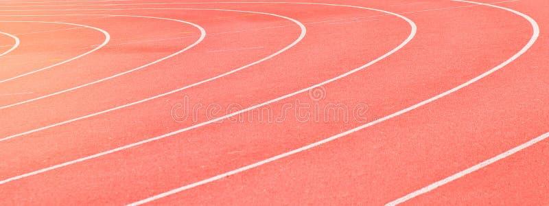 Textura corriente roja de los deportes de la pista imagen de archivo