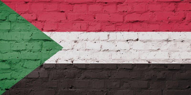 Textura da bandeira de Sudão em uma parede foto de stock