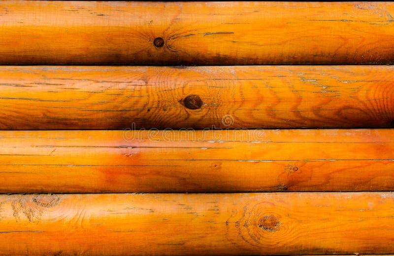 A textura da barra de madeira com um matiz marrom imagem de stock
