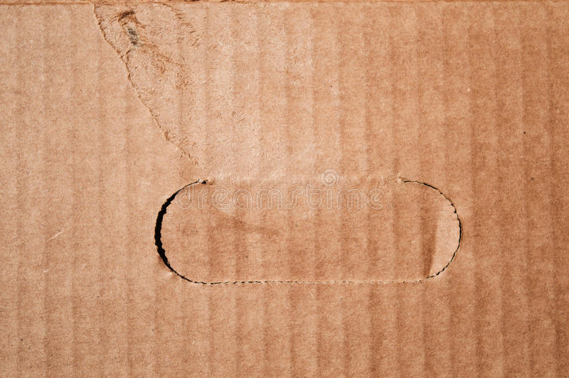 Textura da caixa de cartão marrom danificada limpa com punho cutted fotografia de stock