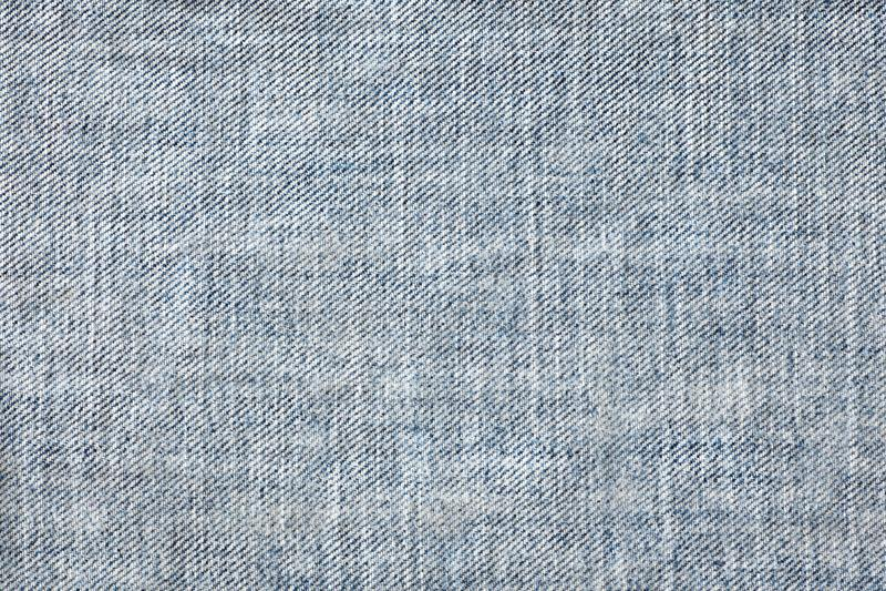 Textura da calças de ganga sem emenda, pano do detalhe da sarja de Nimes para o teste padrão e fundo, fim acima fotos de stock