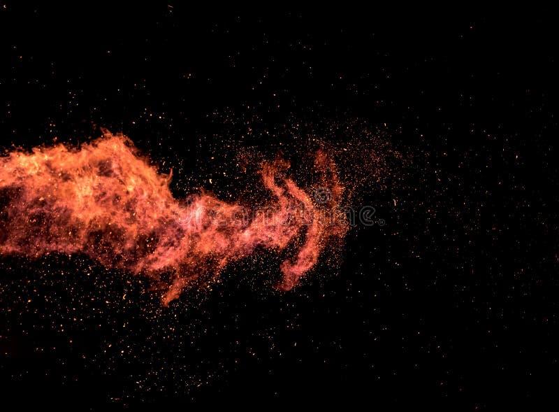 Textura da explosão da chama no fundo preto imagens de stock