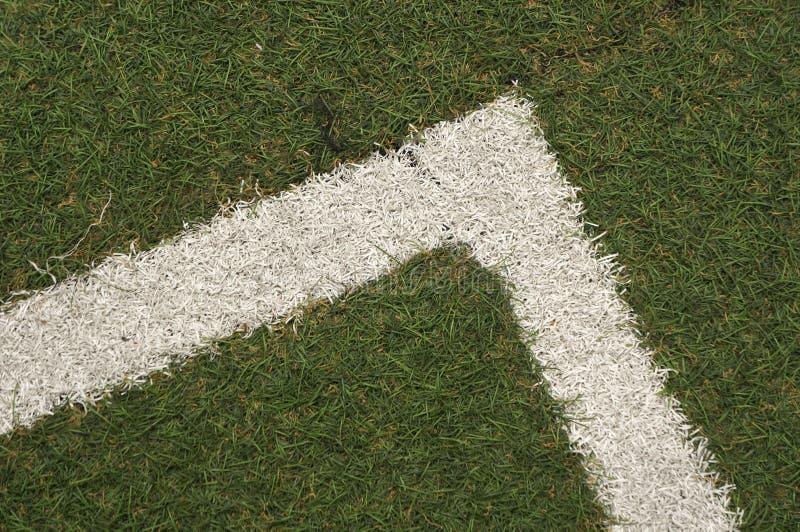 Textura da grama artificial na linha de canto É usado nos esportes fotos de stock royalty free
