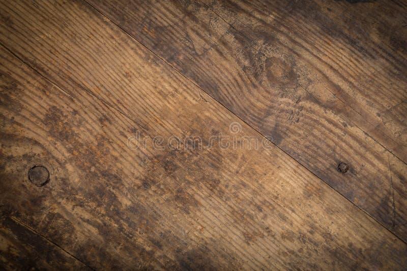 Textura da madeira de Brown abstraia o fundo imagem de stock royalty free