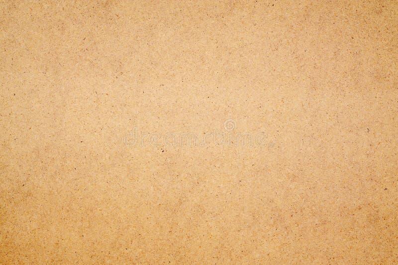 Textura da madeira da placa de Brown feita da madeira de papel reciclada para o uso do fundo imagens de stock