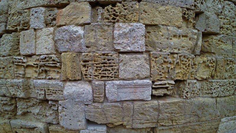 Textura da parede de pedra antiga fotografia de stock