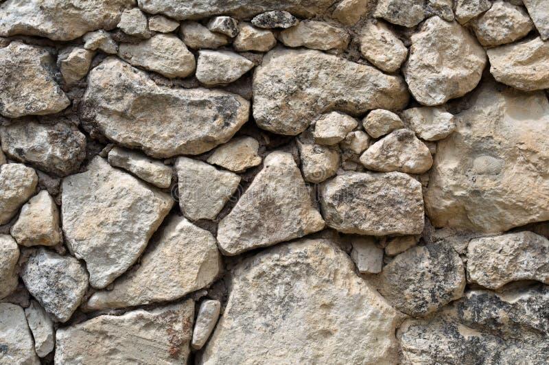 Textura da parede de pedra antiga imagens de stock royalty free
