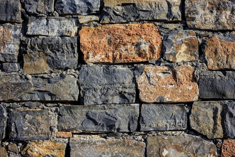 Textura da parede do granito, textura sem emenda, alvenaria dia, pedra natural multi-colorida do granito, partes de pedra, lascas imagens de stock royalty free