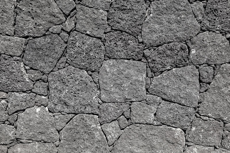 Textura da parede preta da rocha vulcânica de Lanzarote, canário mim fotos de stock royalty free