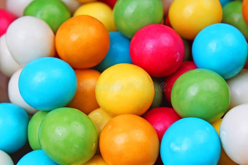 Textura da pastilha elástica da pastilha elástica Pastilhas elásticas coloridos dos gumballs do arco-íris como o fundo Doces reve foto de stock royalty free
