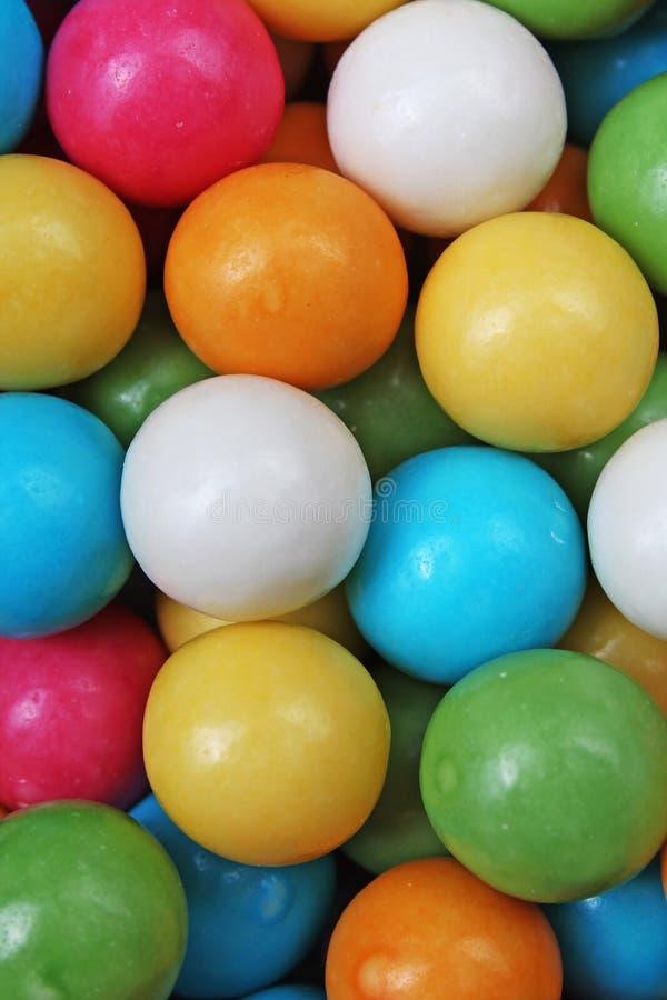 Textura da pastilha elástica da pastilha elástica Pastilhas elásticas coloridos dos gumballs do arco-íris como o fundo Doces reve foto de stock