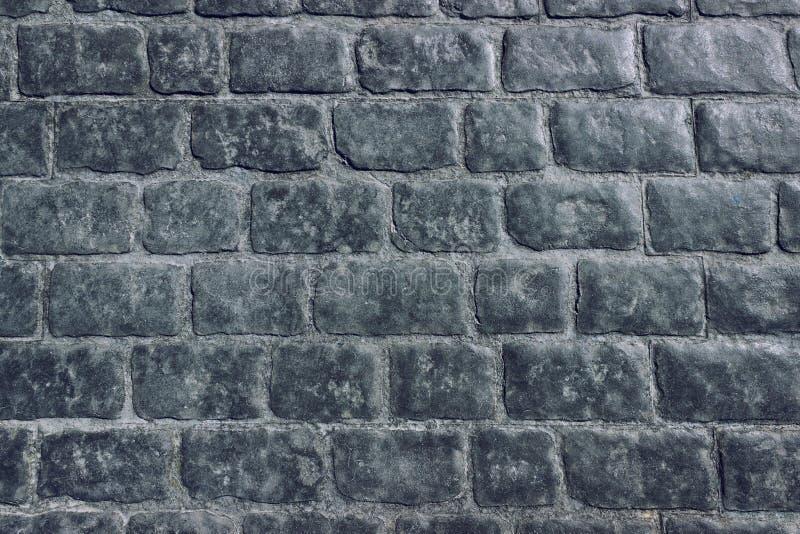Textura da pedra de pavimentação, estrada da pedra Pedra lisa, tempo-lustrada fotografia de stock