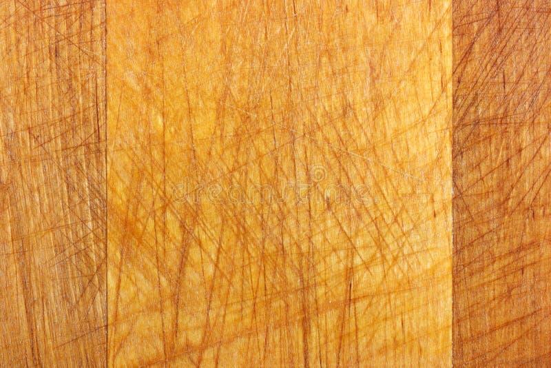Textura da placa de corte de madeira velha com riscos Fundo de madeira natural fotografia de stock royalty free