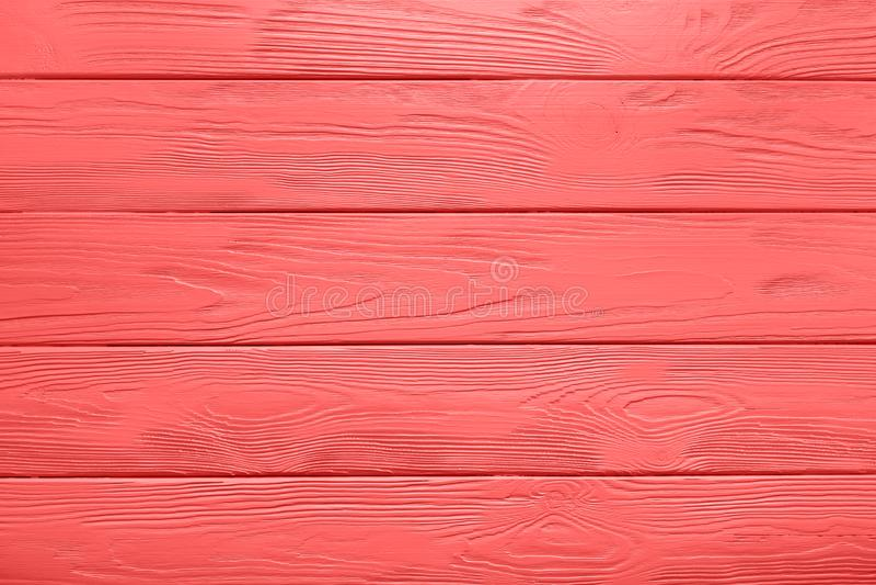 Textura da prancha ou fundo de madeira da tabela pintada em viver Cora fotos de stock