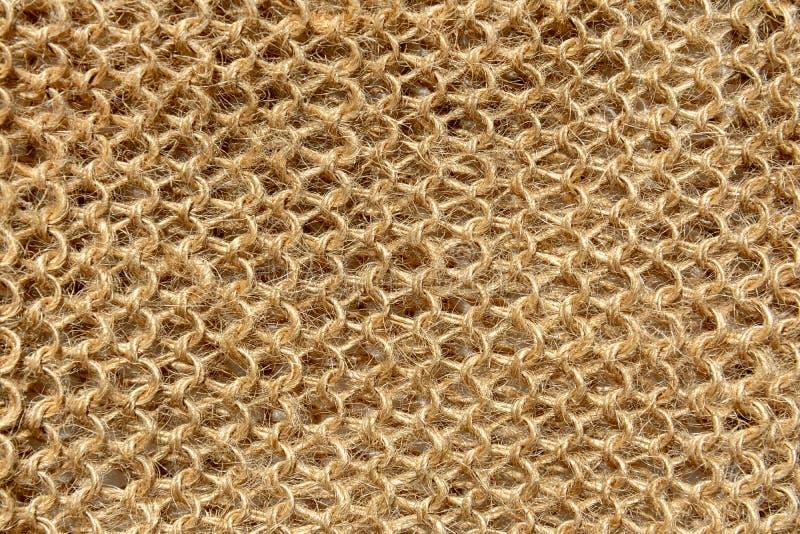 A textura da tela feita malha das linhas de fibras naturais de lãs fotos de stock