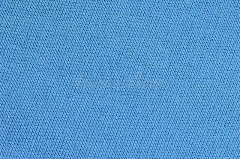 A textura da tela na cor azul Material para fazer camisas e blusas imagem de stock royalty free