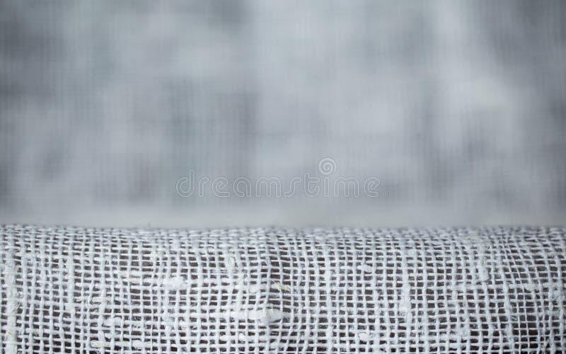 A textura da tela, pano fez malha o fundo fotografia de stock royalty free