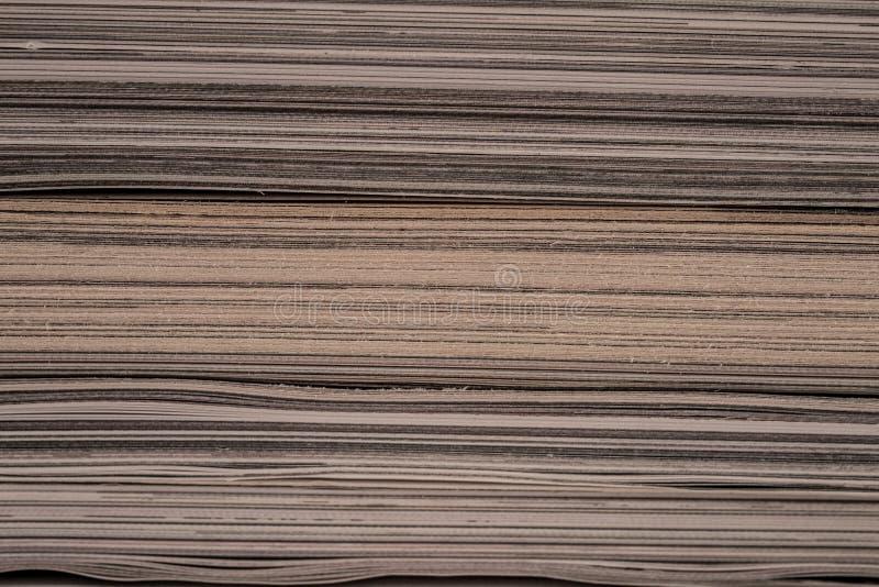 Textura das bordas de páginas amareladas velhas do compartimento fotos de stock