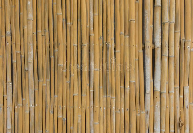 Textura de bambu marrom velha da cerca da prancha imagens de stock royalty free