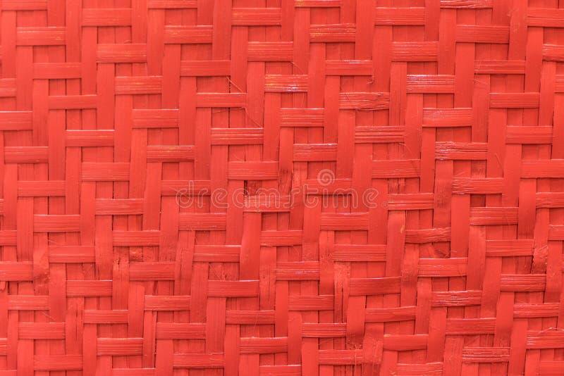 Textura de bambu vermelha do fundo do matting do Weave imagens de stock