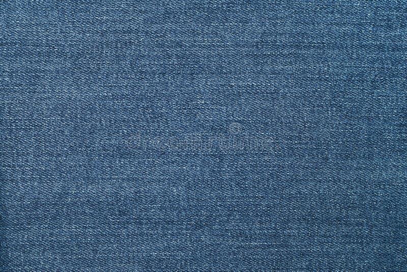 Textura de cal?as de ganga Teste padrão abstrato no fundo azul de brim Textura da sarja de Nimes da lona Fundo material Fundos es foto de stock royalty free