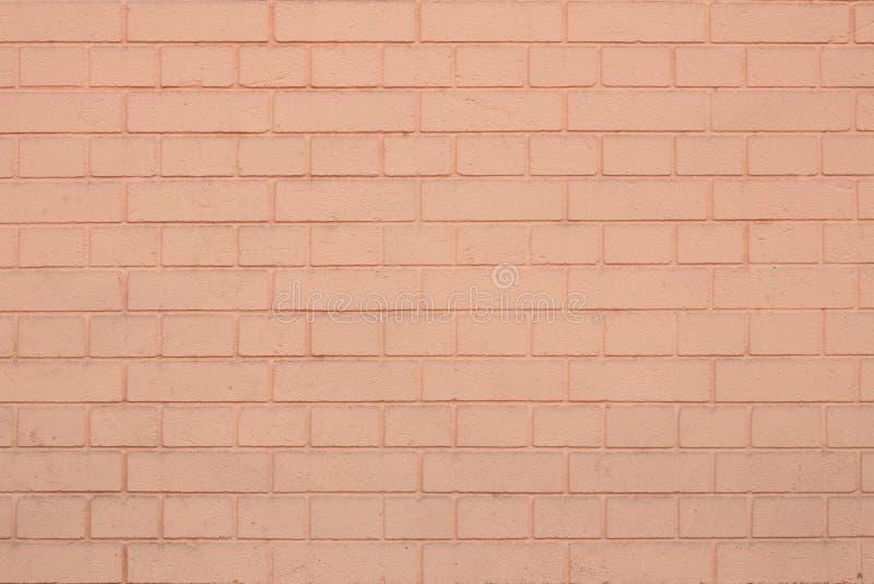 Textura de claro - parede de tijolo alaranjada Espaço vazio Fundo de pedra coral Teste padrão do tijolo no contexto coral Textura foto de stock royalty free