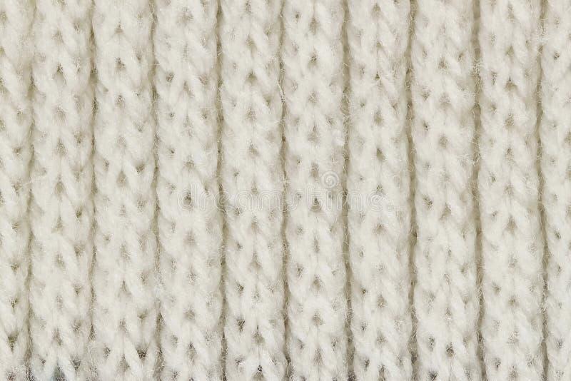 Textura de confecção de malhas branca de lãs para o teste padrão e o fundo fotografia de stock