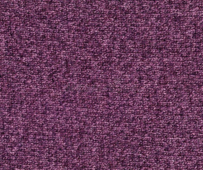 Textura de confecção de malhas de pano da cor magenta foto de stock