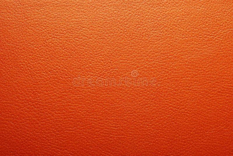Textura de couro alaranjada fotografia de stock royalty free