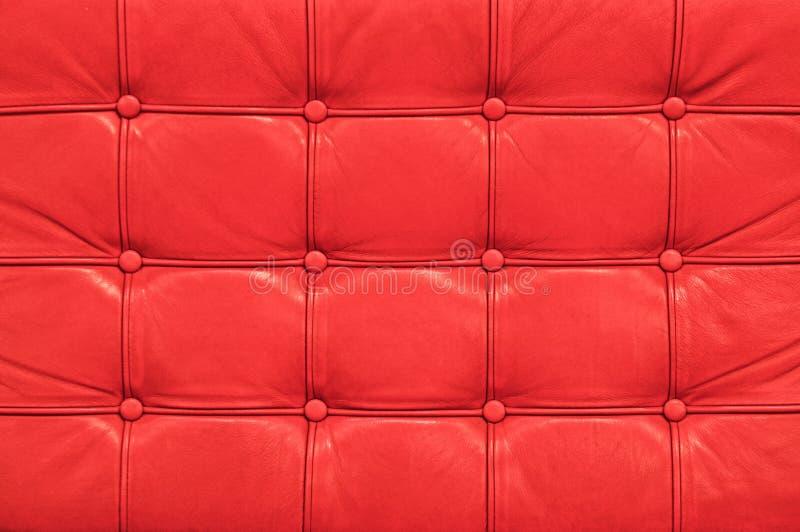 Textura de cuero roja del sofá del vintage imagenes de archivo