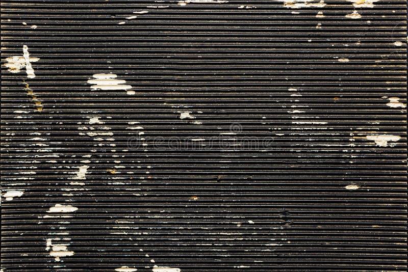 Textura de goma de la placa con los rastros de pintura imagen de archivo