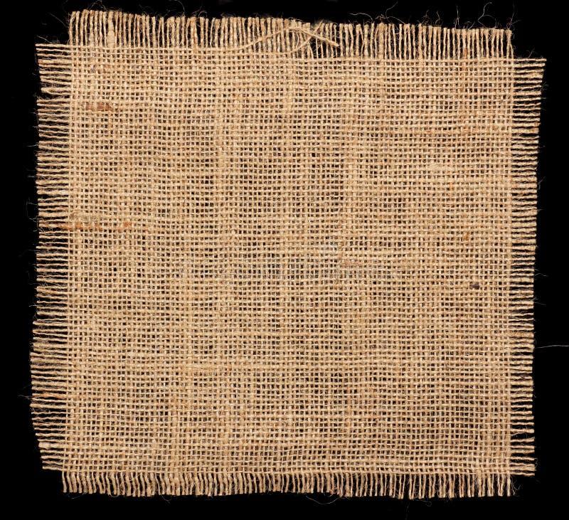 Textura de la arpillera de la arpillera en fondo negro fotografía de archivo libre de regalías