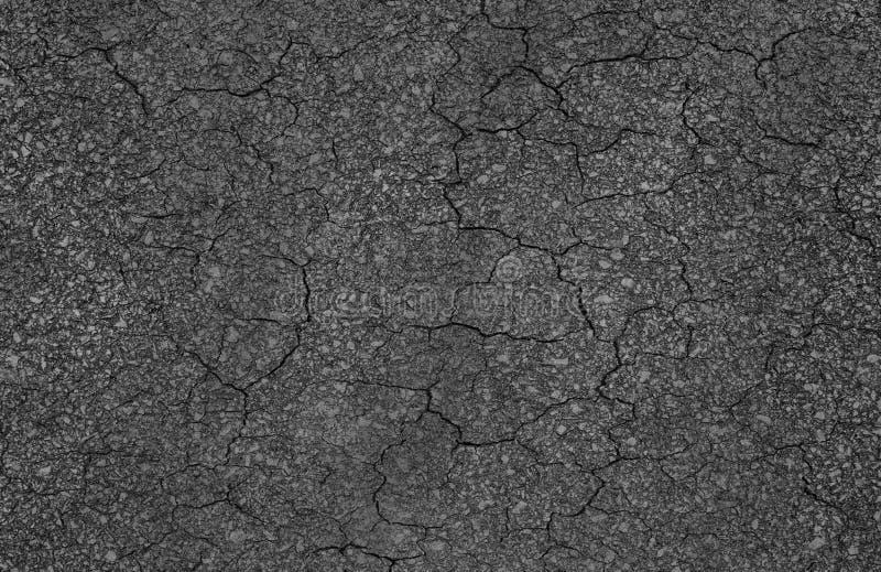 Textura de la grieta de la carretera de asfalto imagenes de archivo