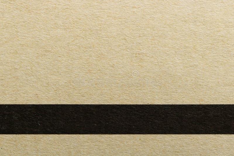 Textura de la línea negra horizontal en el papel de cubierta marrón, fondo abstracto del modelo foto de archivo