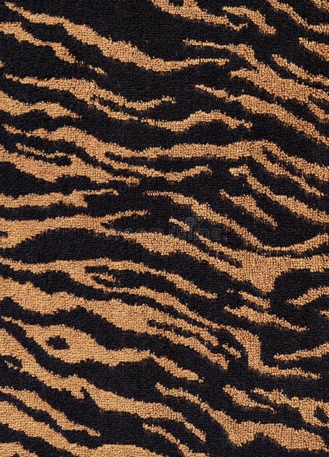 Textura de la materia textil de la tela del tigre fotos de archivo